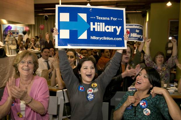 Hillary Clinton supporters Sue Berkel, Erica Bergman and Michelle Garcia cheer while watching election results at a Clinton watch party on Super Tuesday in Austin, Texas.