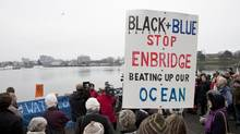 About 75 to 100 people attend a demonstration outside the Delta Ocean Pointe hotel in Victoria to protest the hearings into the Enbridge Northern Gateway project on Jan. 4, 2013. (Duane Prentice for The Globe and Mail)