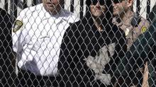 Pop singer Justin Bieber is escorted out of the Turner Guilford Knight Correctional Center in Miami, Fla., Jan. 23, 2014. (Javier Galeano/Reuters)