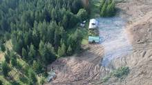 A landslide struck Johnsons Landing, a tiny hamlet on the shores of Kootenay Lake roughly 70 kilometres northeast of Nelson, B.C., Thursday, July 13, 2012, severely damaging three homes. Four people, including a father, his two daughters and a German tourist, were unaccounted for and feared to be caught in the debris. This photo, taken during a British Columbia Ministry of Transportation and Infrastructure geotechnical assessment shows the impact of the slide. (British Columbia Ministry of Transportation and Infrastructure/THE CANADIAN PRESS)