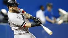 Boston Red Sox Mike Napoli hits three run home run against the Toronto Blue Jays during the seventh inning of their MLB American League baseball game in Toronto, May 1, 2013. It was Napoli's second home run of the game. (MARK BLINCH/REUTERS)