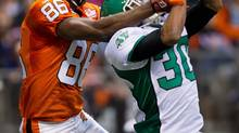 Saskatchewan Roughriders' Terrell Maze, right, knocks down a pass intended for B.C. Lions' Courtney Taylor in the endzone during the first half of a pre-season CFL game in Vancouver, B.C., on Wednesday June 13, 2012. (DARRYL DYCK/THE CANADIAN PRESS)