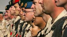 FILE PHOTO: Canadian soldiers take part in the last Remembrance Day ceremony after troops finished their combat mission there in July at Kandahar Air Field, November 11, 2011. (Ryan Remiorz/Reuters)