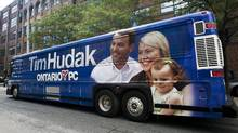 Ontario PC Leader Tim Hudak's newly unveiled campaign bus is seen on Ontario Street in Toronto on Monday, August 29, 2011. (Aaron Vincent Elkaim/THE CANADIAN PRESS/Aaron Vincent Elkaim/THE CANADIAN PRESS)