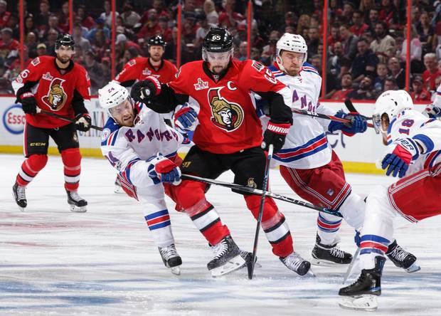 Erik Karlsson battles through Rangers players in Game 1 of second round play in the 2017 playoffs.