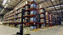 Amazon.com's massive warehouses are a signal of how technology will reduce the number of jobs in the retail sector. (RUSSELL CHEYNE/REUTERS)