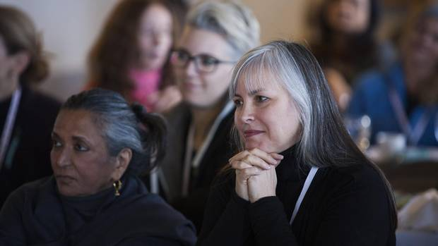 Women In the Director's Chair (WIDC) executive director Carol Whiteman, right, attends the Women on Top Breakfast in Whistler on Dec. 3, 2016.