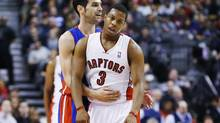 Detroit Pistons' Jose Calderon hugs Toronto Raptors' Kyle Lowry (3) during the first half of their NBA game in Toronto April 1, 2013. This game is the first time Calderon has returned to Toronto since being traded to Detroit. (MARK BLINCH/REUTERS)