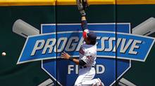 Cleveland Indians Shin-Soo Choo is unable to make a catch as he jumps against the wall after a ball hit by Toronto Blue Jays Adam Lind during the first inning of their MLB American League baseball game in Cleveland, Ohio July 1, 2010. REUTERS/Aaron Josefczyk (AARON JOSEFCZYK)