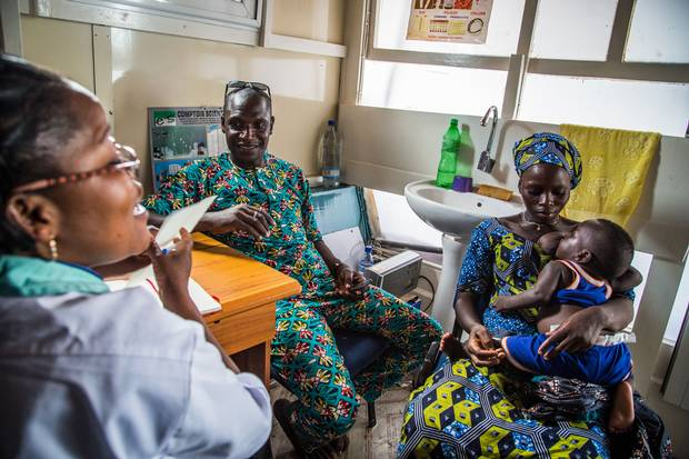 Simplicia Zannou and her husband Kokossou Bourasma consult a nurse about birth control on a mobile clinic boat in the So-Ava commune of Benin. Simplicia will find out later she is pregnant.