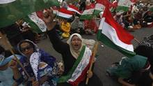 A supporter of Tahir ul Qadri, a Sufi cleric and leader of the Minhaj-ul-Quran religious organization, chants slogans as she participates in a sit-in protest in Karachi on June 23, 2014. (AKHTAR SOOMRO/REUTERS)