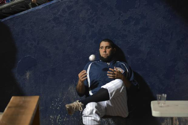 Ismel Jimenez in the Quebec Capitales dugout. Four Cuban baseball players were legally allowed to leave the country to play baseball in Canada for the Quebec Capitales. This is a new venture for Cuba which is now only beginning to see a thaw in it's relationship with the United States.
