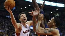 Toronto Raptors Andrea Bargnani goes to the basket against Indiana Pacers Roy Hibbert (C) and Gerald Green (R) during the first half of their NBA game in Toronto, October 31, 2012. (MARK BLINCH/REUTERS)