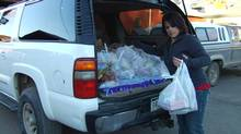 Leslie Nichols, a 5th grade teacher in Collbran, Colo., loads groceries into her vehicle.