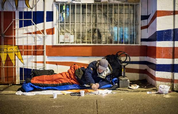 Richie Carter prepares his drugs on East Hastings Street, not far from Insite.