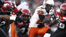 BC Lions' Stefan Logan (26) runs against the Calgary Stampeders during the first half of their CFL Western Final game in Calgary, Alberta, November 15, 2008. (ANDY CLARK/REUTERS)