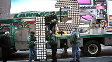 The number 13, to be used atop One Times Square, arrives outside the Times Square Museum and Visitor Center in New York, Dec. 19, 2012. A big theme of 2013 in this column was the outperformance of U.S. and global markets in comparison to Canada. (Andrew Burton/Reuters)
