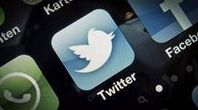 A Twitter app is shown on a smartphone in Germany. Quebec courtrooms will become Twitter-free zones come Monday as new rules governing the use of electronic communications and technology come into effect. (Timur Emek/AP)