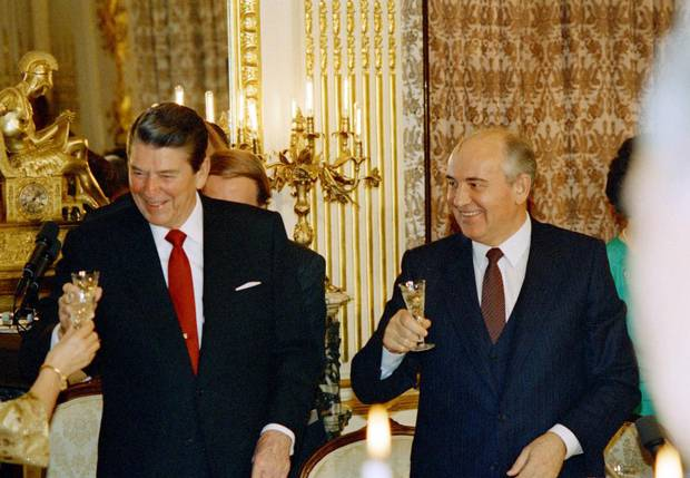 Ronald Reagan and Mikhail Gorbachev share a toast during a dinner at the Soviet Embassy during the Soviet leader's state visit in 1987.