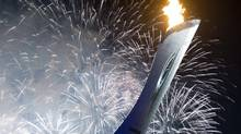 Fireworks illuminate the night sky as the Olympic cauldron is lit at the opening ceremonies for the Sochi Winter Olympics Friday February 7, 2014 in Sochi, Russia. (Adrian Wyld/THE CANADIAN PRESS)