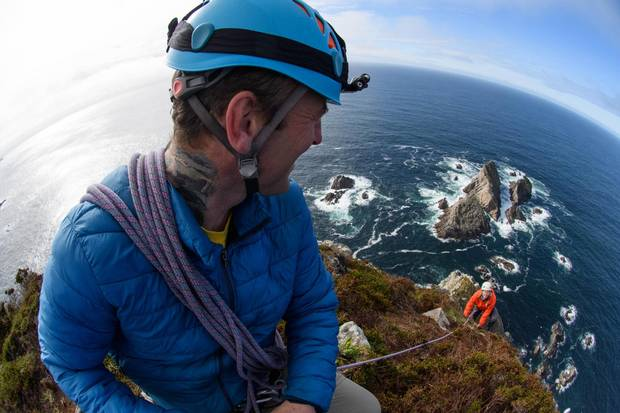The Sturrall Headland, a dark, forbidding stack to the south, makes for a challenging climb.