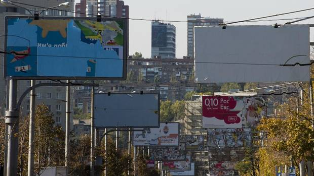 Derelict billboards in Donetsk: All the turmoil has blighted a once-vibrant (and Western-oriented) economy in a city that Vlad now describes as a big 'prison.'