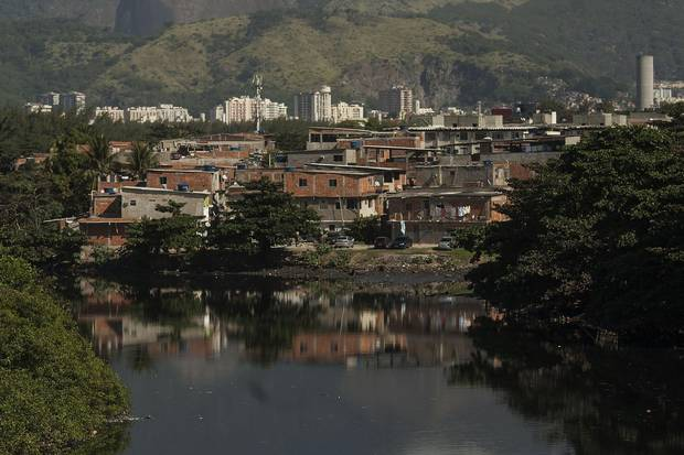 Residences in the Mare favela next to the Cunha channel throw sewage directly in Guanabara Bay waters.