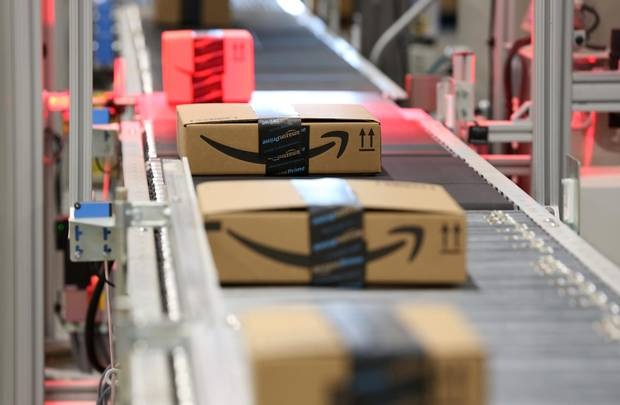 Packages move along a conveyer belt at the Amazon fulfillment centre in Brampton, Ont., July 21, 2017.