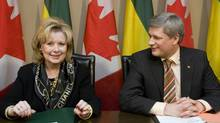 Prime Minister Stephen Harper, right, smiles at Senator Pamela Wallin during a round table meeting with business leaders in Saskatoon, Sask., Friday, Feb. 27, 2009. Harper, who appointed Wallin to the Senate in early 2009, is now under fire after an audit of Wallin found she claimed more than $100,000 in questionable expenses. (GEOFF HOWE/The Canadian Press)