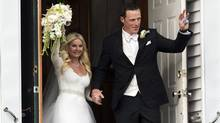 Toronto Maple Leafs captain Dion Phaneuf and actress Elisha Cuthbert head from their wedding at St. James Catholic Church in Summerfield, P.E.I. on Saturday, July 6, 2013. (Andrew Vaughan/THE CANADIAN PRESS)