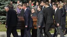 Pallbearers, including NHL hockey player Jason Spezza, exit Islington United Church with the casket containing the remains of ski-cross racer Nik Zoricic following Zoricic's funeral in Toronto, Monday. (Tim Fraser/Tim Fraser/The Globe and Mail)