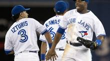 Toronto Blue jays Maicer Izturis (left) and Rajai Davis (right) celebrate after defeating the Colorado Rockies in AL action in Toronto on Monday June 17, 2013. Izturis hit the game winning single to score Davis. (Frank Gunn/The Canadian Press)
