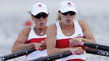 Canada's Lindsay Jennerich and Patricia Obee row in the women's lightweight double sculls heat at Eton Dorney during the London 2012 Olympic Games July 29, 2012. (Reuters)