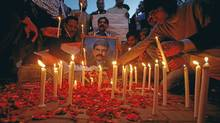 Men light candles during a candlelight vigil in commemoration of assassinated Pakistani Minister for Minorities Shahbaz Bhatti, in Lahore. (Mohsin Raza/Reuters/Mohsin Raza/Reuters)