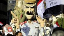 Egyptians opposing President Mohamed Morsi hold an effigy mocking him in Tahrir square in Cairo February 8, 2013. (MOHAMED ABD EL GHANY/REUTERS)