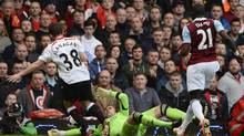 Liverpool's Jon Flanagan (L) during a socce rmatch at Upton Park in London, April, 2014. (DYLAN MARTINEZ/REUTERS)