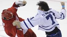 Toronto Maple Leafs right wing David Clarkson (71) fights Detroit Red Wings defenseman Jonathan Ericsson (52) during the third period of an NHL hockey game in Detroit, Friday, Sept. 27, 2013. (Associated Press)