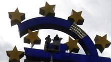 Workers maintain the huge Euro logo next to the headquarters of the European Central Bank (ECB) in Frankfurt, December 6, 2011. (RALPH ORLOWSKI/RALPH ORLOWSKI/REUTERS)