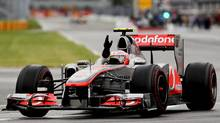 McLaren driver Jenson Button of Great Britain celebrates after winning the Canadian Formula One Grand Prix at the Circuit Gilles Villeneuve on June 12, 2011 in Montreal, Canada. (Paul Gilham/Paul Gilham/Getty Images)
