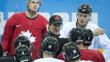 Canada's men's head coach Mike Babcock, centre, explains a drill to his players at hockey practice during the 2014 Sochi Winter Olympics in Sochi, Russia on Wednesday, February 12, 2014. (Nathan Denette/THE CANADIAN PRESS)
