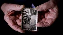 World War II veteran Bernard Jackson, 91, holds a photograph of himself taken in 1945 after the war at his home in Vancouver, B.C., on Wednesday June 4, 2014. (DARRYL DYCK/THE GLOBE AND MAIL)