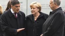 German Chancellor Angela Merkel, centre, listens to Romani Rose, left, head of the Central Council of German Sinti and Roma, during the inauguration Oct. 24, 2012, in Berlin of the Memorial to the Sinti and Roma of Europe murdered under National Socialism. At right is State Minister for Culture Bernd Neumann. (THOMAS PETER/REUTERS)