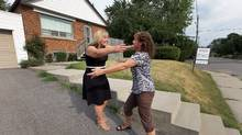 Realtor Rochelle DeClute congratulates homeowner Sandra Davis after selling her Toronto home for $13,000 more than the asking price.   (Deborah Baic/The Globe and Mail staff)