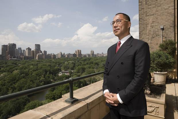 Guo Wengui, a Chinese billionaire involved in a public feud with a business rival, stands on the terrace of his Manhattan apartment.