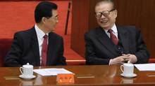 China's President Hu Jintao, left, talks with former president Jiang Zemin at the commemoration of the 100th anniversary of the Xinhai Revolution at the Great Hall of the People in Beijing on Oct. 9, 2011. (Minoru Iwasaki/Pool/REUTERS)