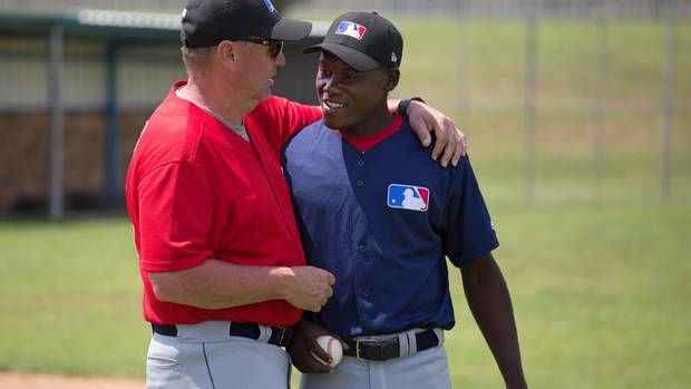Garth Iorg with Ezekiel Kisitu, a baseball player from Uganda.