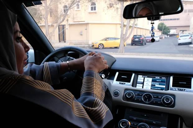 A Saudi woman drives her car along a street in the Saudi coastal city of Jeddah, on Sept. 27, 2017.