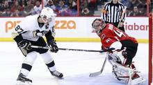 Pittsburgh Penguins' captain Sidney Crosby scores on Ottawa Senators goalie Craig Anderson during the shootout in their game in Ottawa Jan. 27, 2013. (BLAIR GABLE/REUTERS)