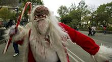 Santa takes part in a Zombie Walk at the Revolution Monument in Mexico City. (ALFREDO ESTRELLA/ALFREDO ESTRELLA/AFP/Getty Images)