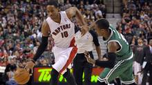 Toronto Raptors forward DeMar DeRozan drives past Boston Celtics guard Rajon Rondo during the second half of their NBA basketball game in Toronto April 13, 2012. (Reuters)
